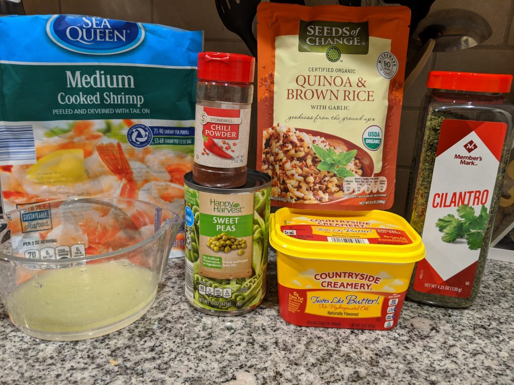 Ingredients for Chili Lime Shrimp Over Quinoa: Shrimp, lime juice, chili powder, peas, quinoa & brown rice, light butter, and cilantro.