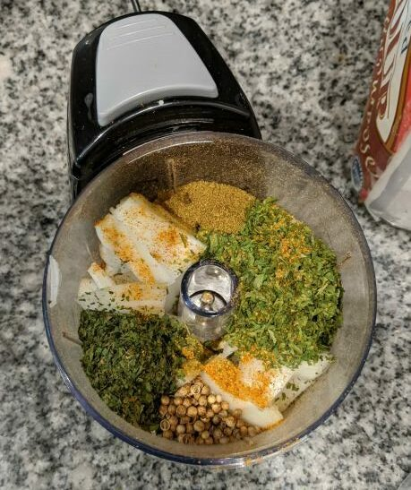 Falafel Ingredients in Chopper - Cilantro, Parsley, Cumin, Coriander Seeds, and Onion