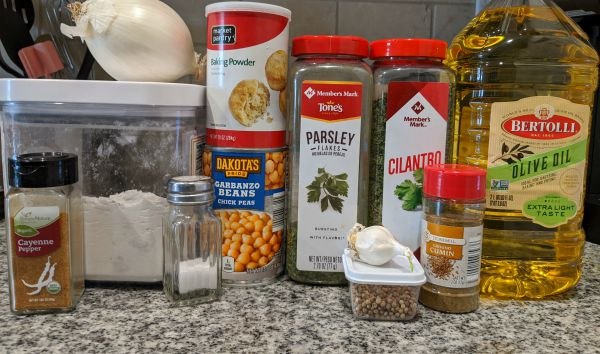 Falafel Ingredients - Cayenne Pepper, Onion, Flour, Salt, Baking Powder, Chickpeas, Parsley, Cilantro, Garlic, Coriander, Cumin, Olive Oil