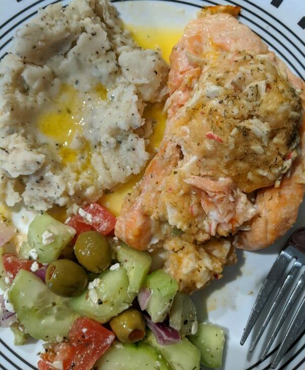 Plate with Mashed Potatoes, Cucumber Salad, and Crab Stuffed Salmon from Costco