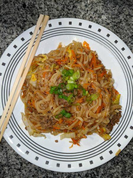 Hoisin Beef Noodles on plate with chopsticks