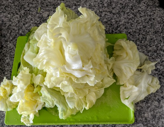 Cabbage leaves on cutting board