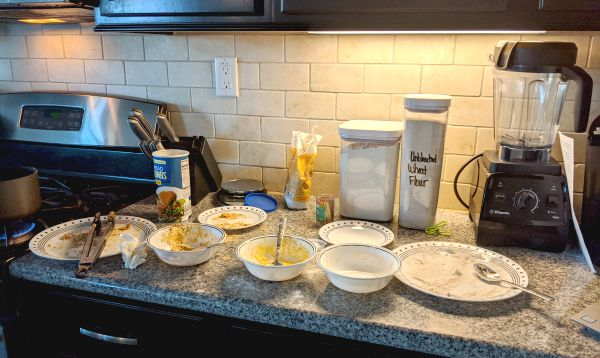 Chicken Kiev Breading Process, bread crumbs, flour, on plates and bowls