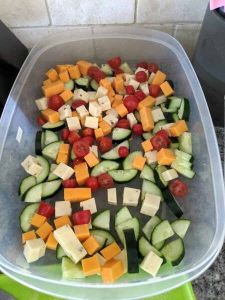 Cucumbers, Tomatoes and Cubed Cheeses in container
