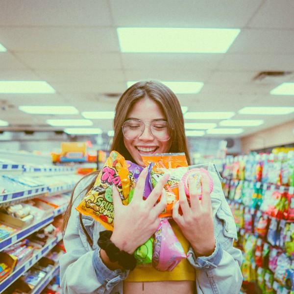 Fetch Rewards - Earn Cash Back on Groceries - Woman Grocery Shopping
