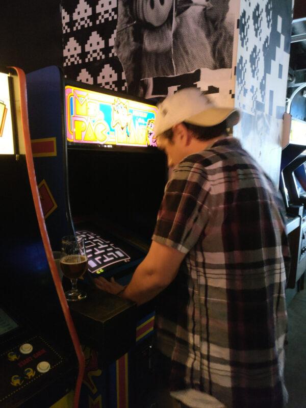 Man playing Ms. Pac-Man at Up Down Kansas City