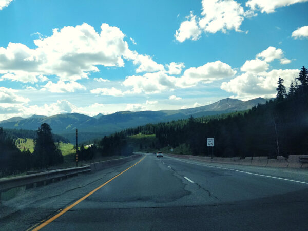 HIghway surrounded by trees and mountains outside of Copper Mtn. Colorado