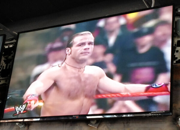 Wrestling match on television at Up Down Kansas City